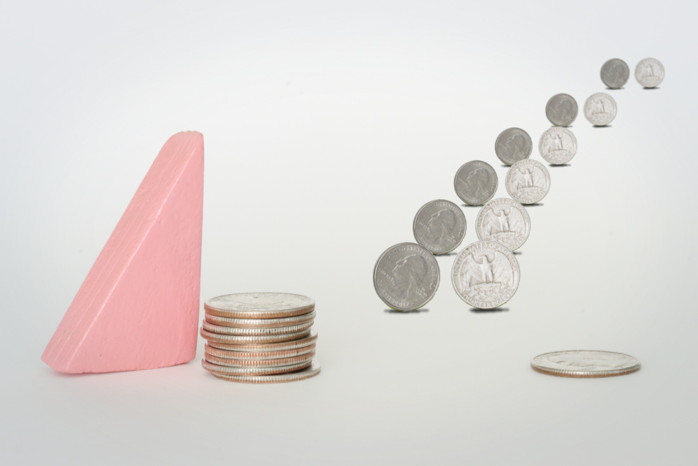 Flow FP's block woman beside a stack of quarters. A second, smaller stack represents a company match. Matches pairs of quarters, one from each stack, walk into the distance.